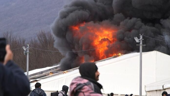 refugee camp on fire in bosnia